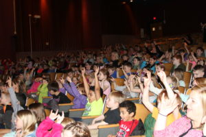 Cedar Rapids and Linn Mar students chair dance to Pete the Cat and His Four Groovy Buttons.